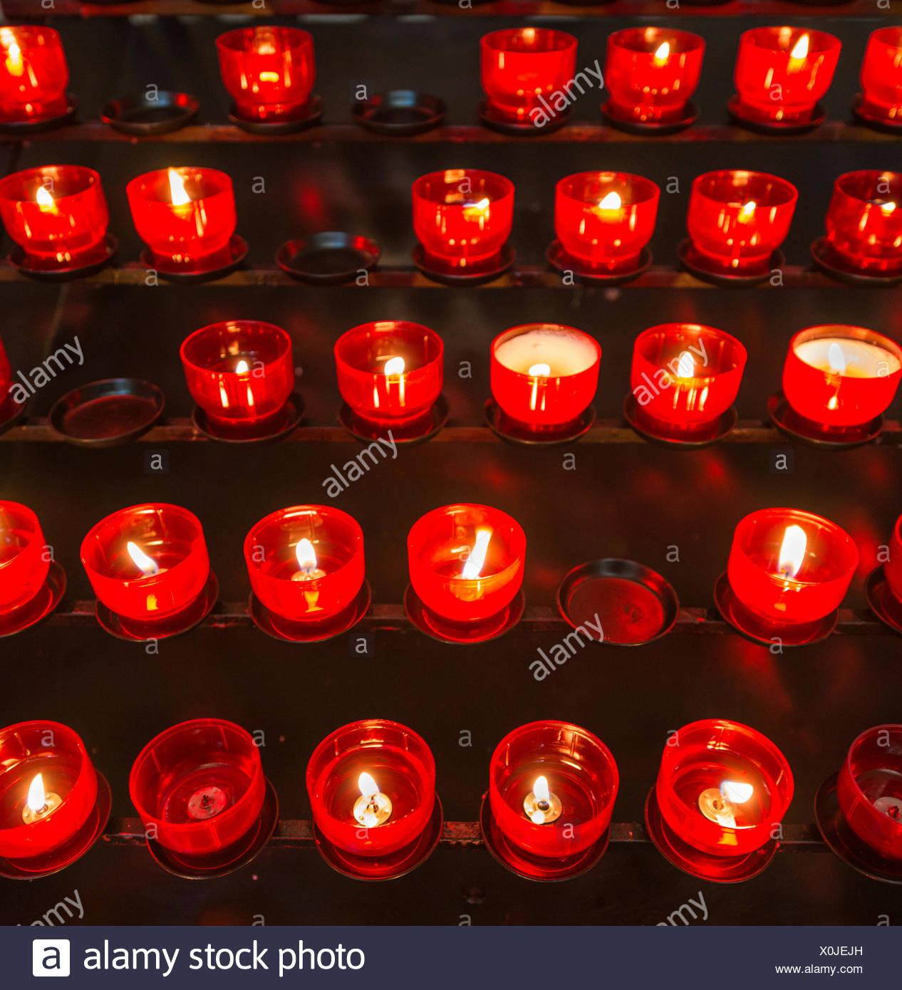 Burning votive candles in a church, Munich, Upper Bavaria, Bavaria, Germany - Stock Image