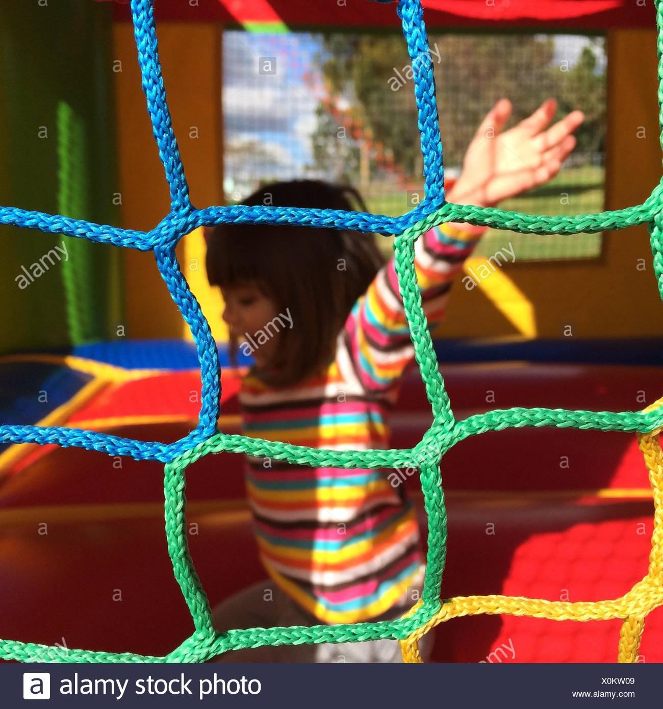 Girl Having Fun In Playground - Stock Image