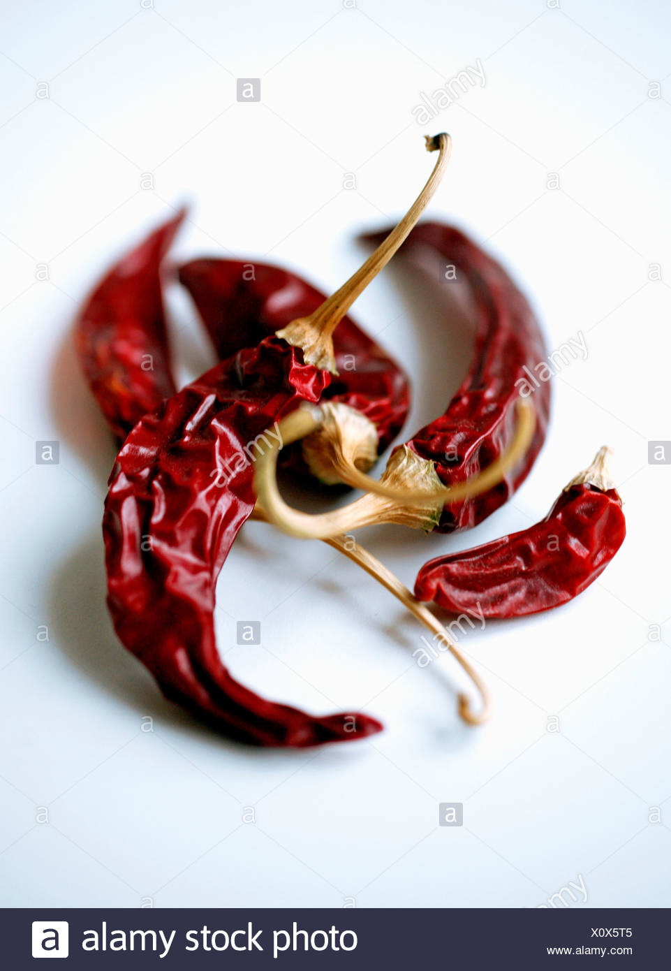 Chili peppers over white background - Stock Image