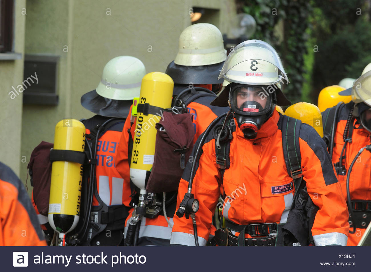 Firefighter action at a room fire, Ostfildern, Baden-Wuerttemberg, Germany, Europe - Stock Image