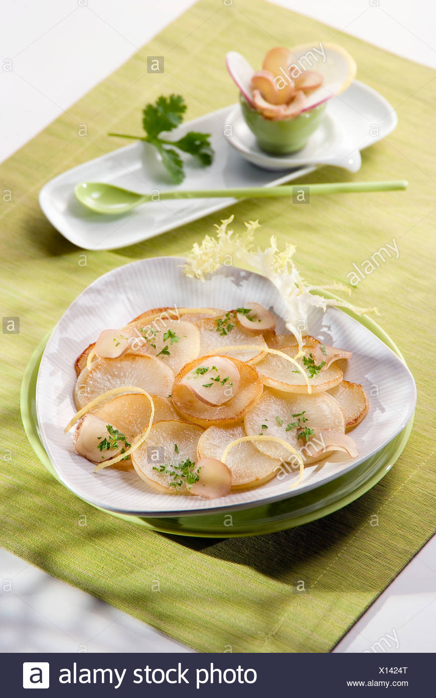 Steam-cooked young turnips - Stock Image