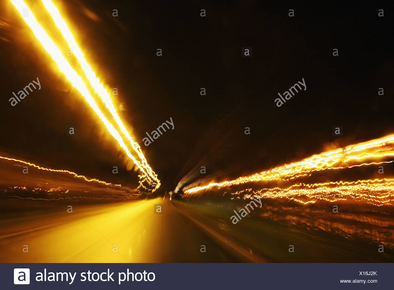 Tail lights on road at night - Stock Image
