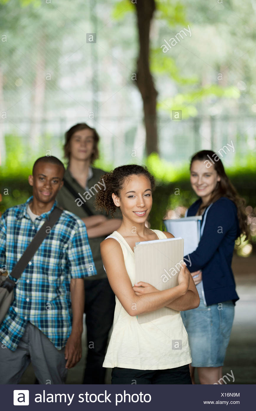 University students, focus on woman in foreground - Stock Image