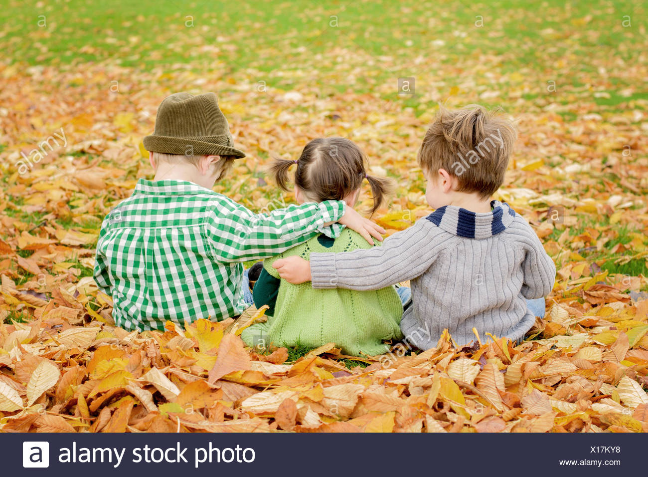 Three children ( 2-3, 4-5 ) hugging - Stock Image