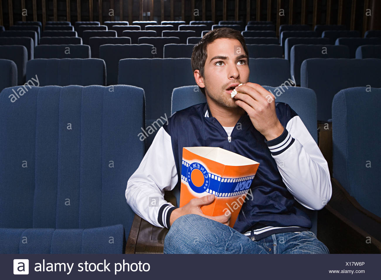 Man alone in the cinema - Stock Image