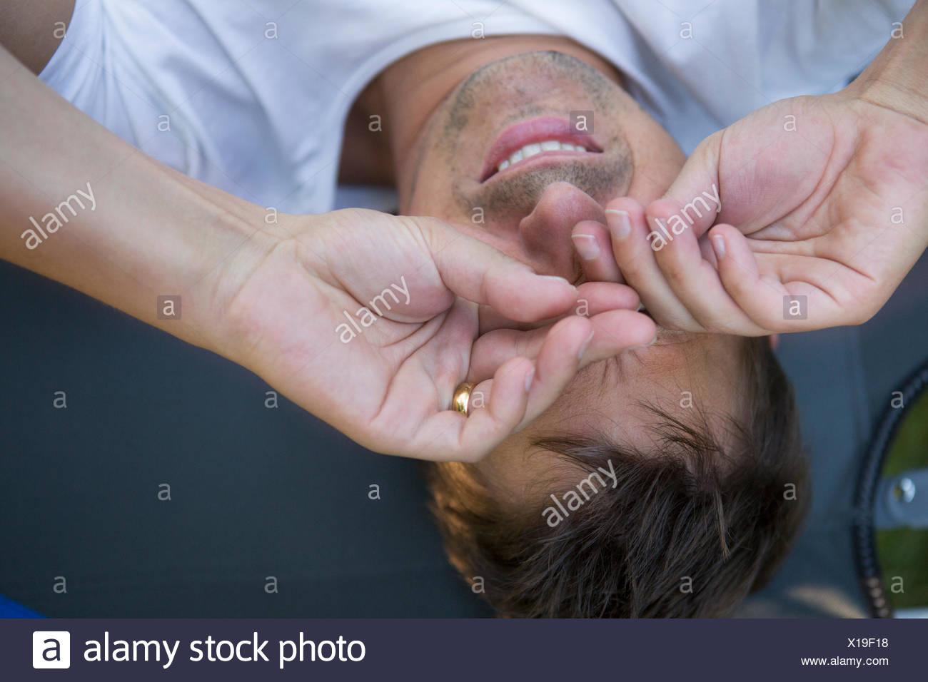 Man rubbing eyes - Stock Image