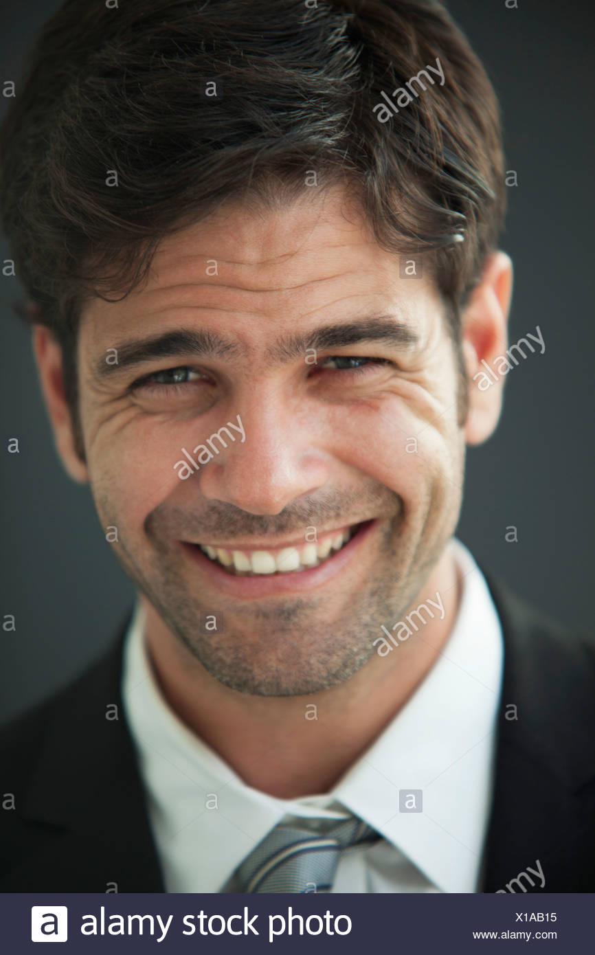 Man smiling happily, portrait - Stock Image