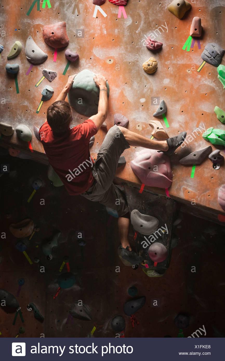 USA, Utah, Sandy, man on indoor climbing wall - Stock Image