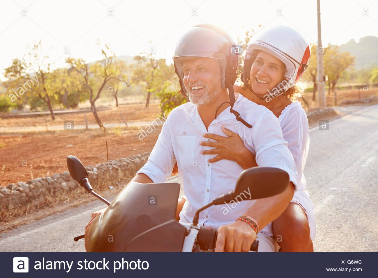 two men riding motorcycle along stock photos & two men riding