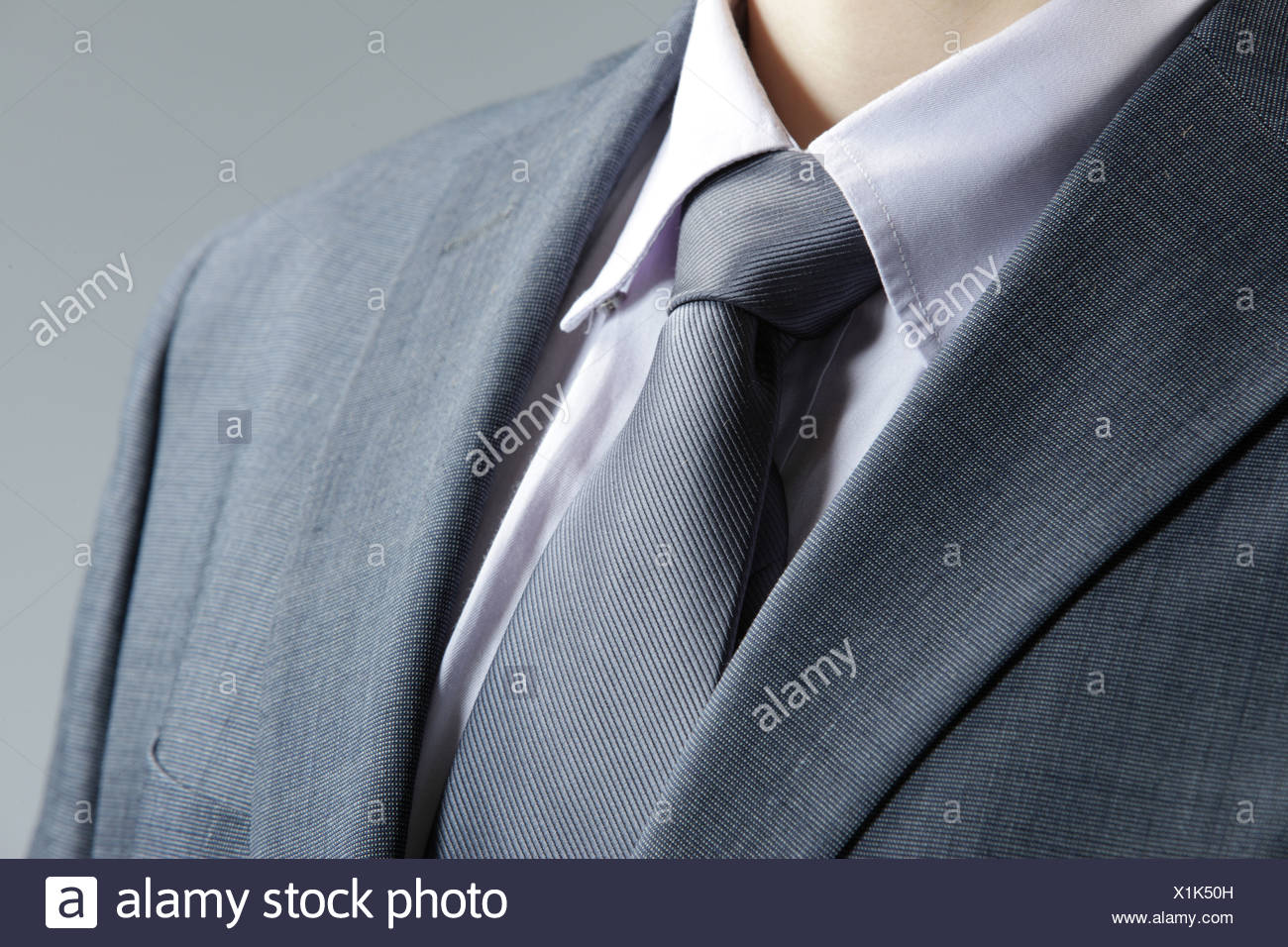 Close up of classic business attire with  tie and elegant blazer. - Stock Image