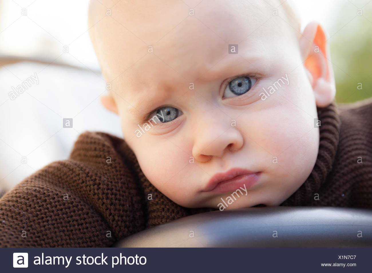Portrait of baby boy with blue eyes (12-17 months) - Stock Image