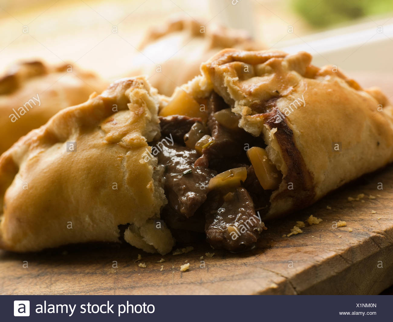 Traditional Cornish Pasty broken open - Stock Image