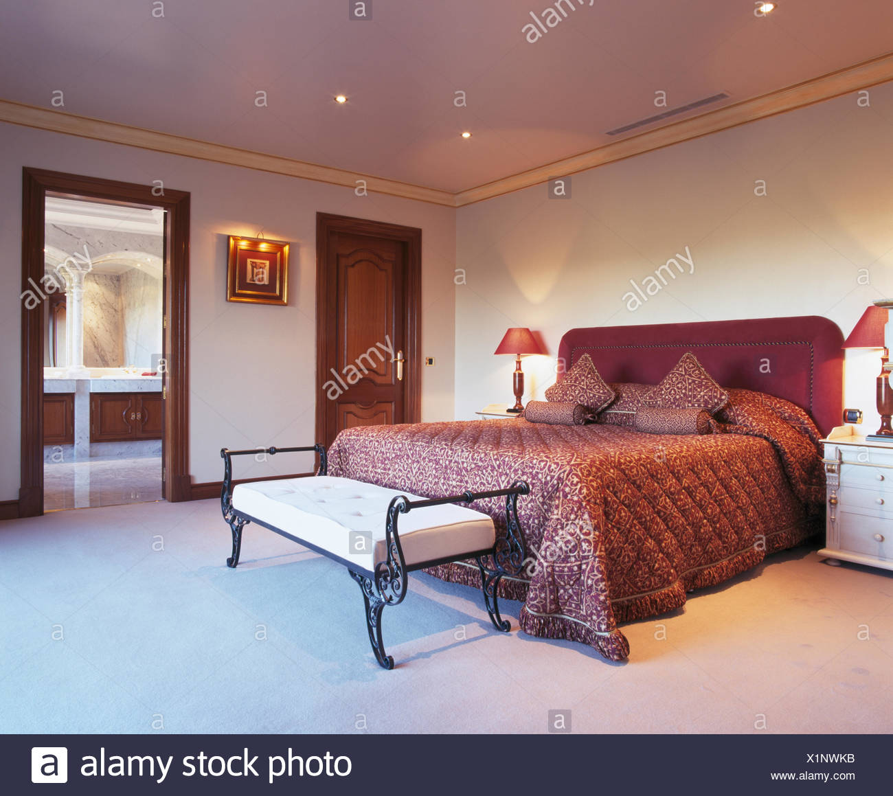 Deep Pink Quilt And Cushions On Bed In Spanish Bedroom With White