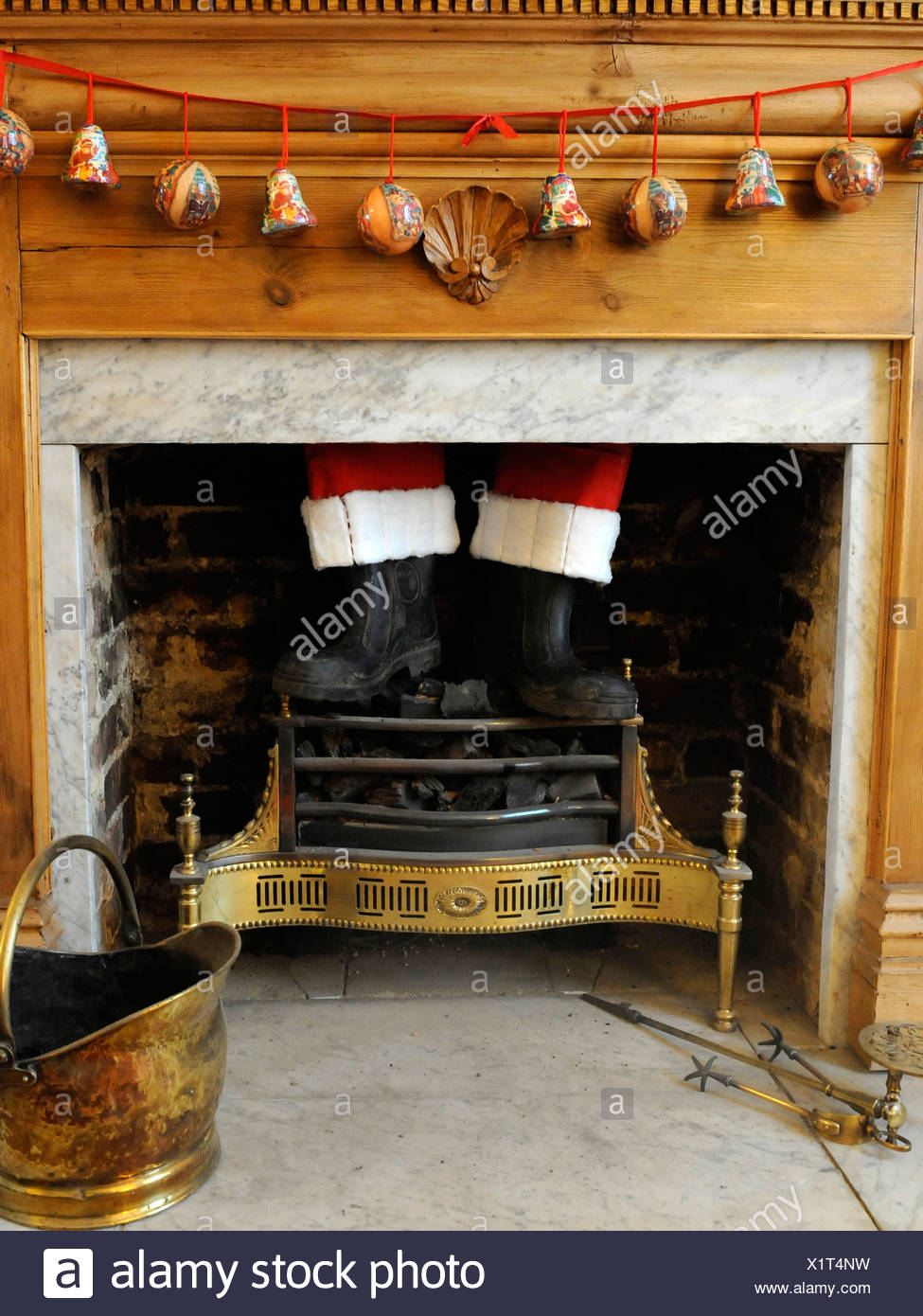 Father Christmas coming down the chimney - Stock Image