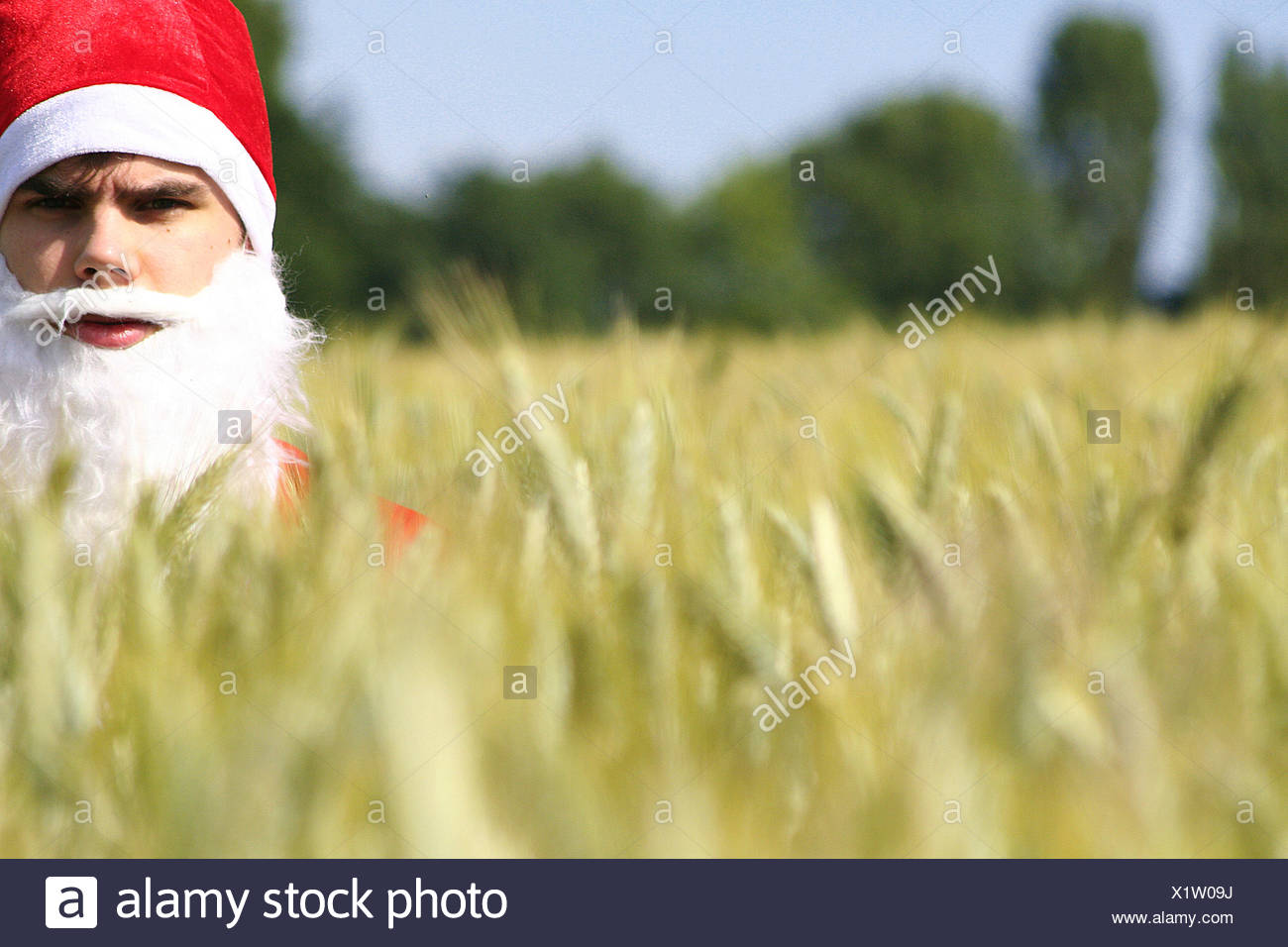 contrasts,santa clause,global warming - Stock Image