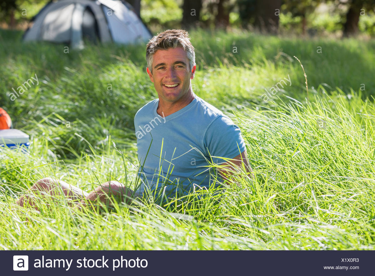 Man Relaxing On Camping Trip In Countryside - Stock Image
