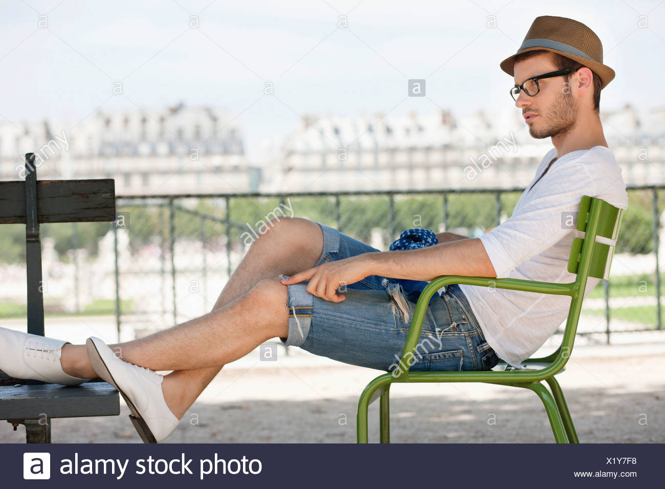 Man resting in a chair, Jardin des Tuileries, Paris, Ile-de-France, France - Stock Image