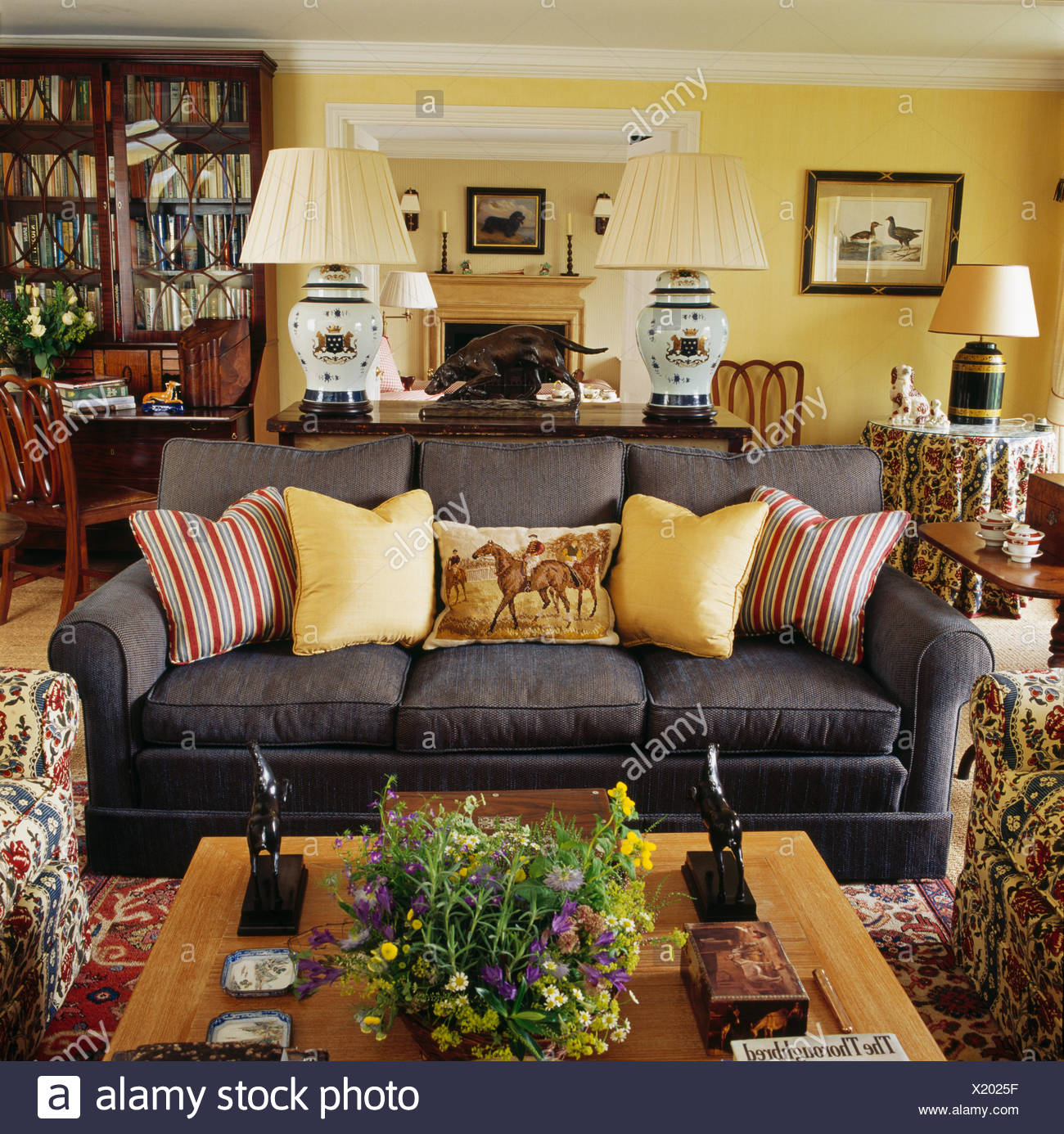 Attrayant Pale Yellow And Striped Cushions On Dark Grey Sofa In Yellow Country Living  Room