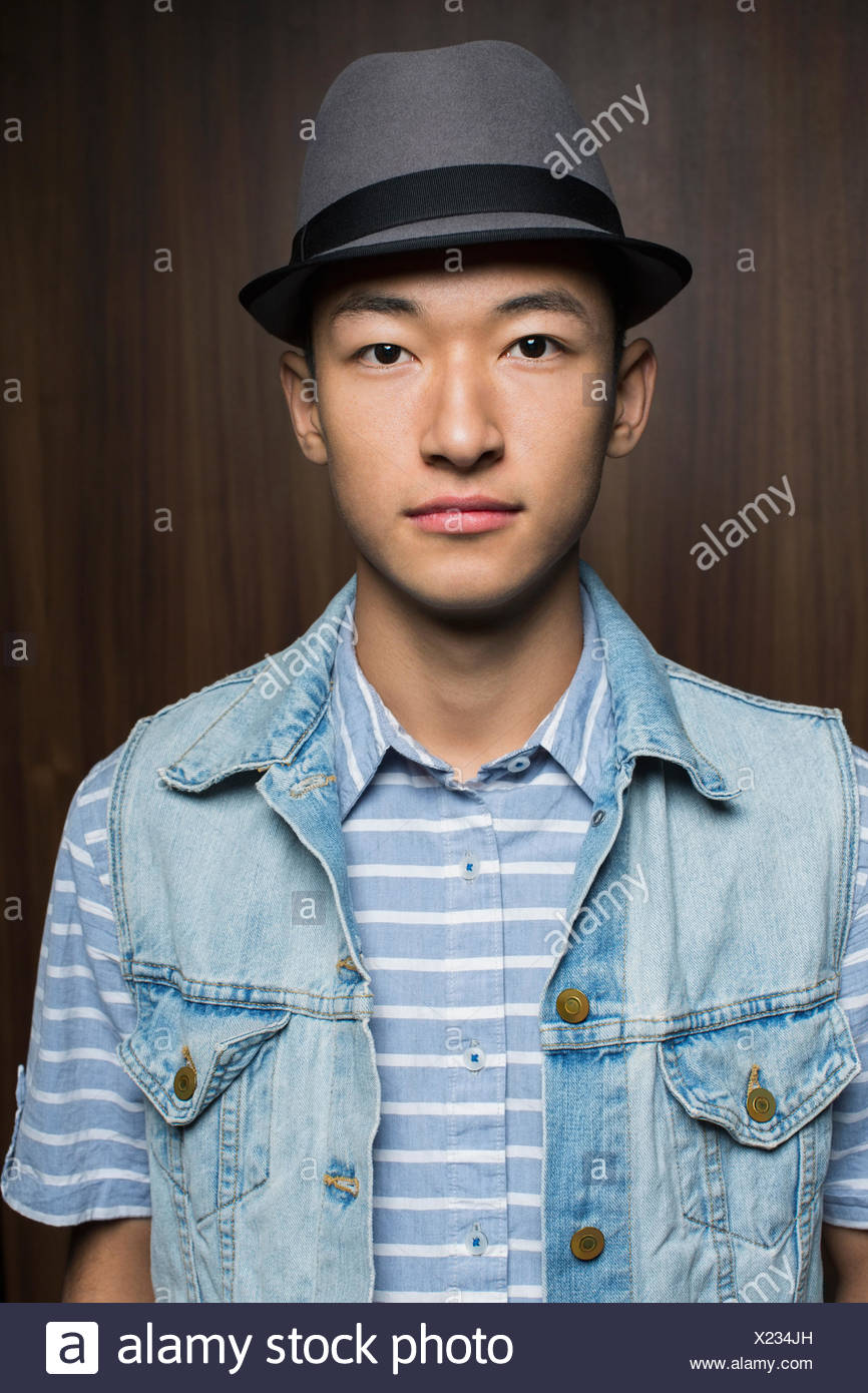 Portrait of serious man wearing fedora - Stock Image