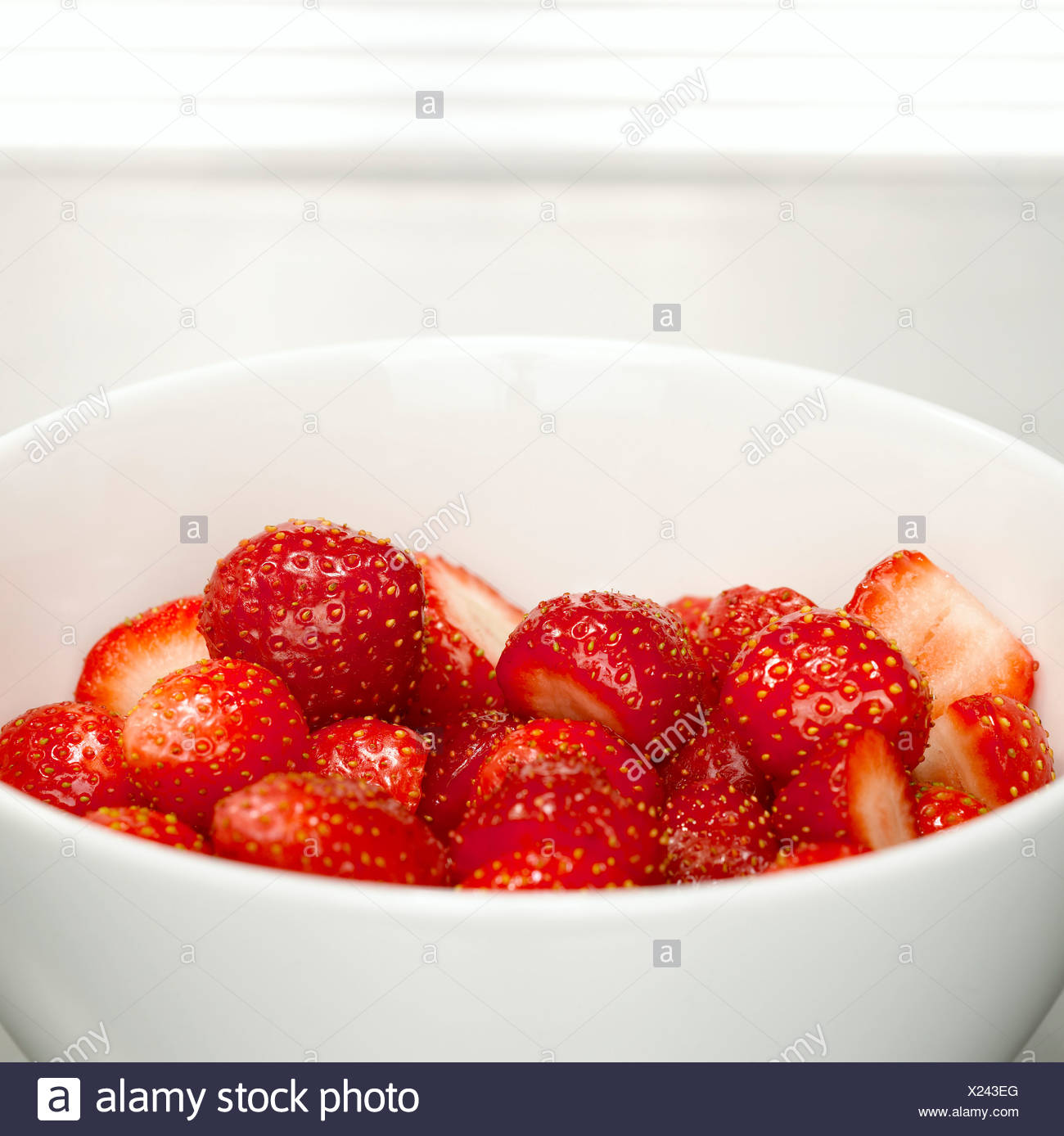 Fresh strawberries in bowl, close-up - Stock Image