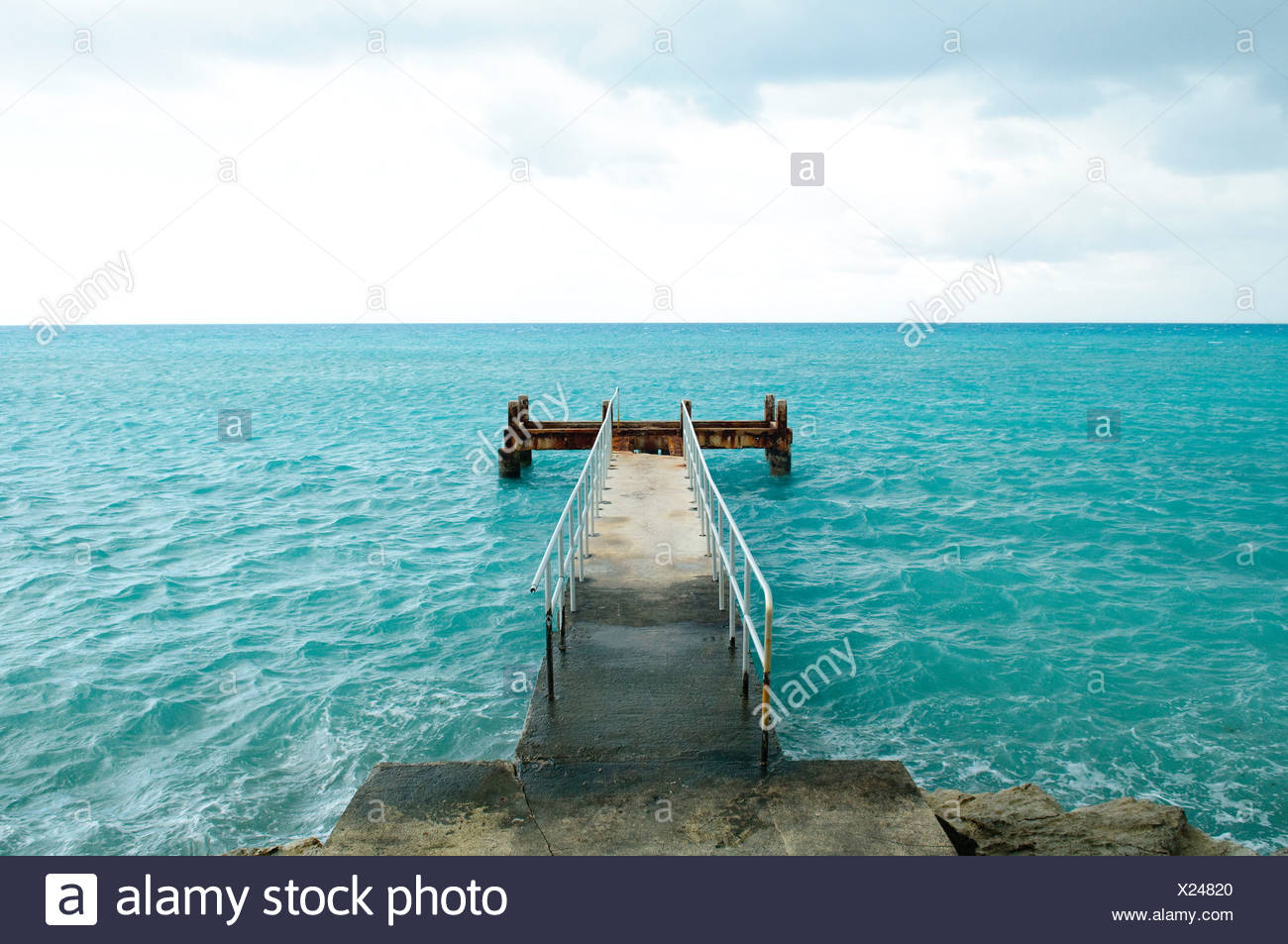 Pier going into blue sea, St. George's Parish, Bermuda - Stock Image