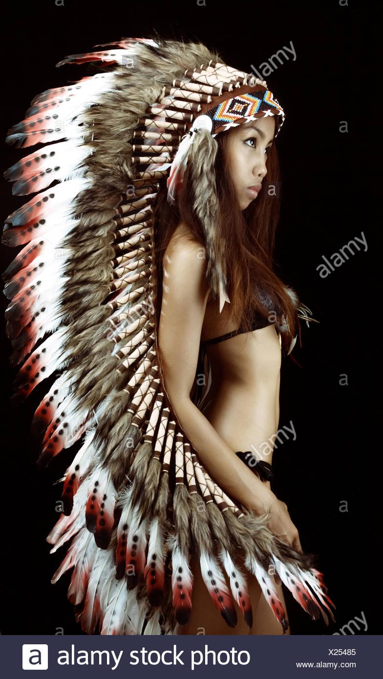 Studio shot of woman wearing traditional plume - Stock Image