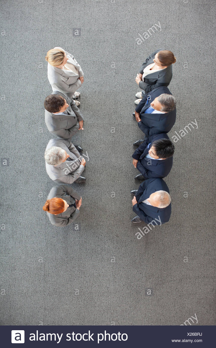 High angle view of business people in a row - Stock Image