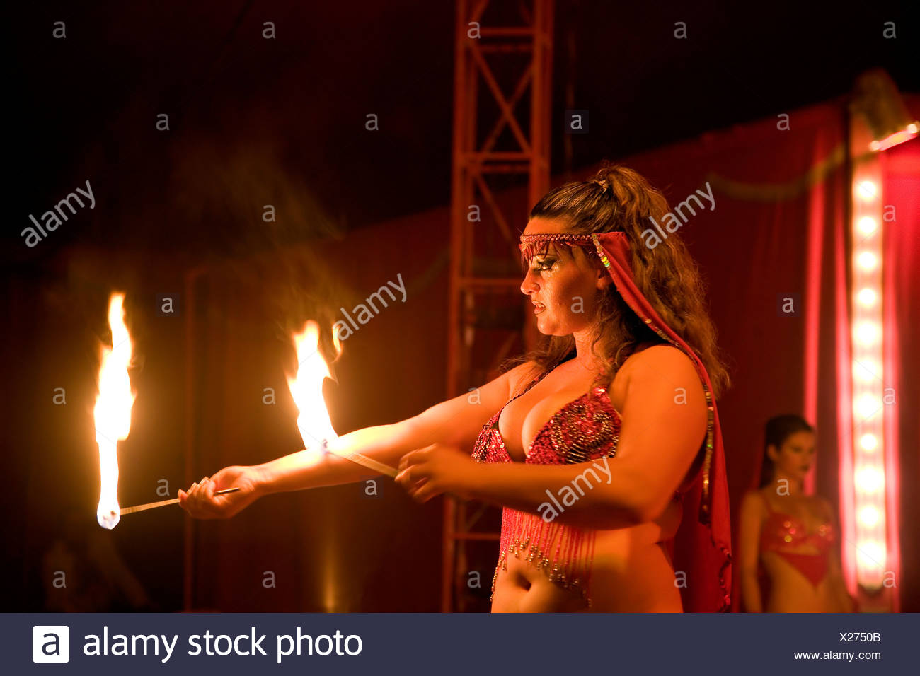 A artiste shows tricks with fire, Monti circus - Stock Image