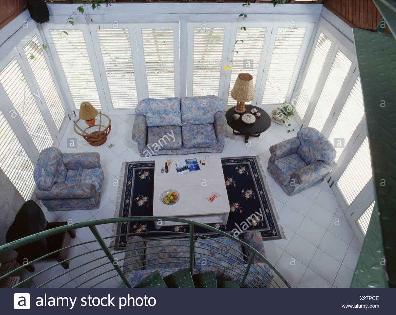 Aerial View Of Patterned Blue Sofa And Armchairs In Coastal Living