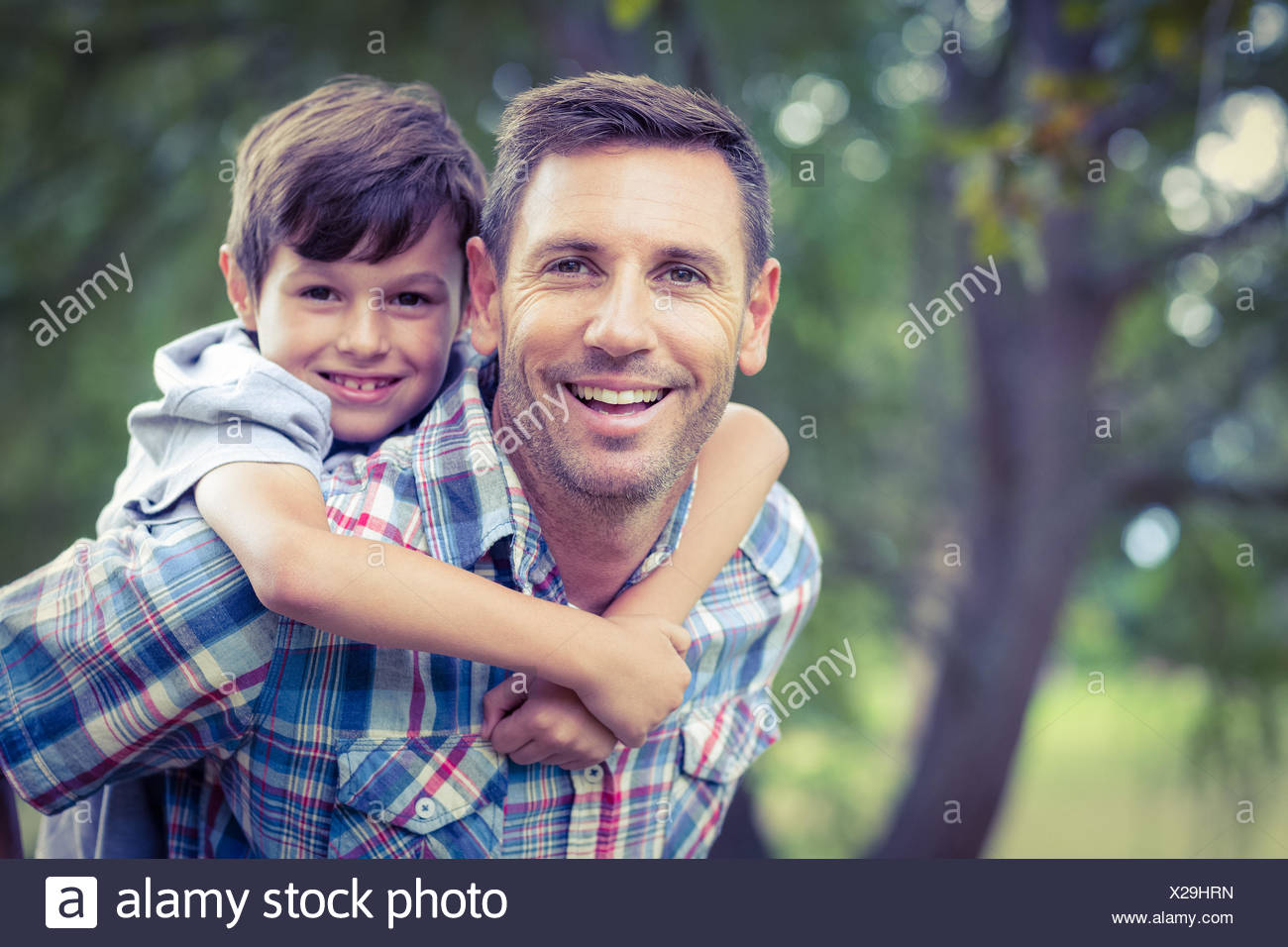Child playing with his father - Stock Image