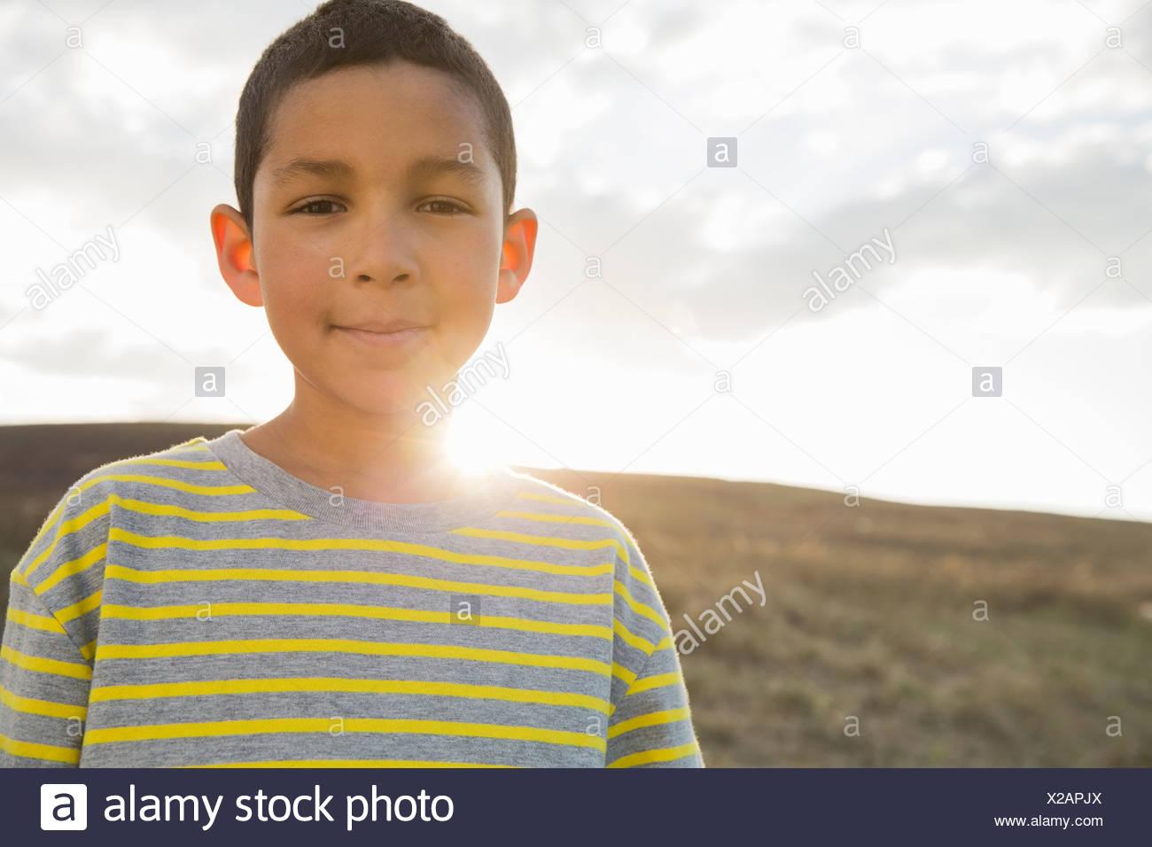 Portrait of schoolboy smiling - Stock Image