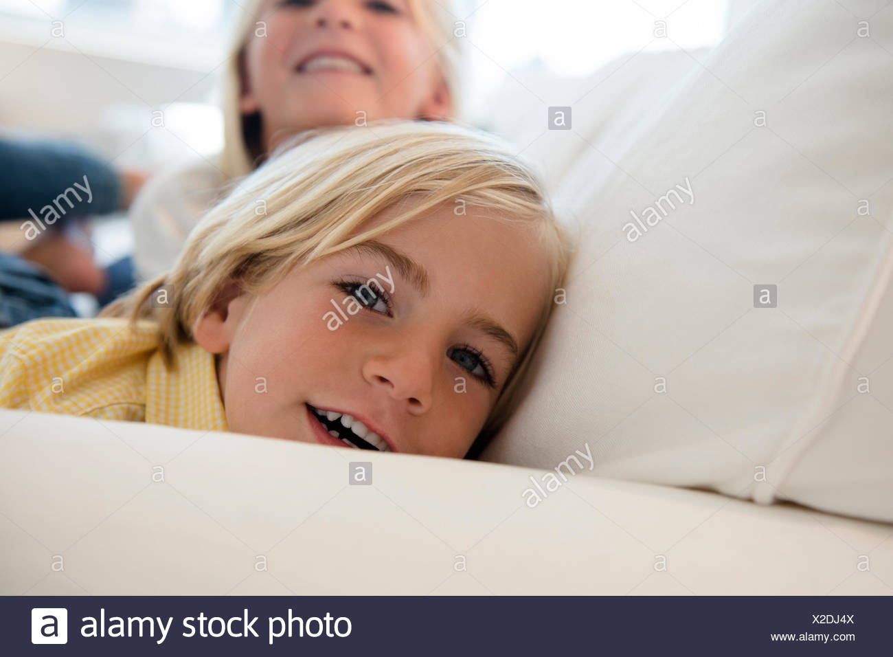 Boy (4-5) and girl (6-7) looking at camera - Stock Image