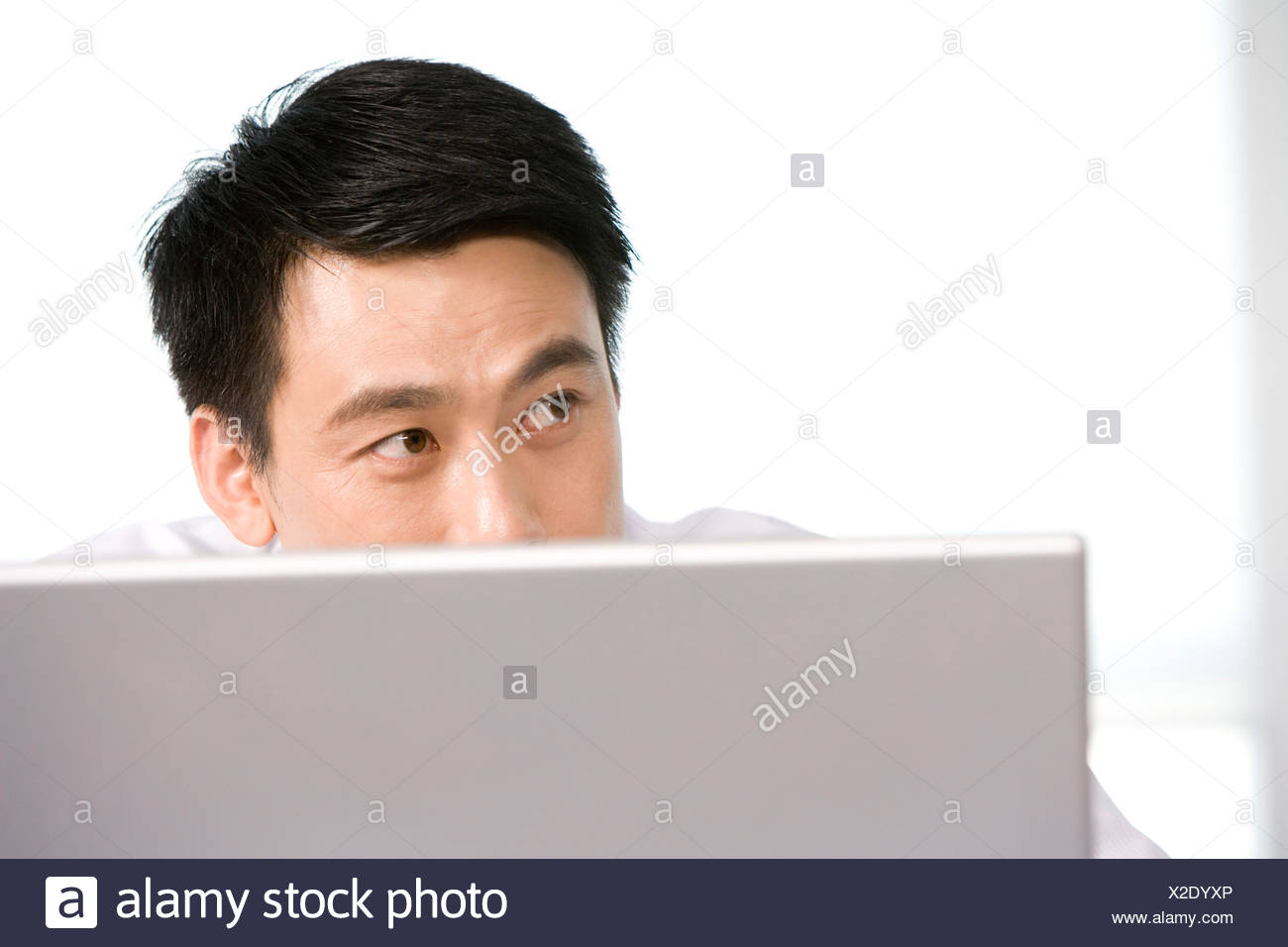 Office worker at his desk - Stock Image
