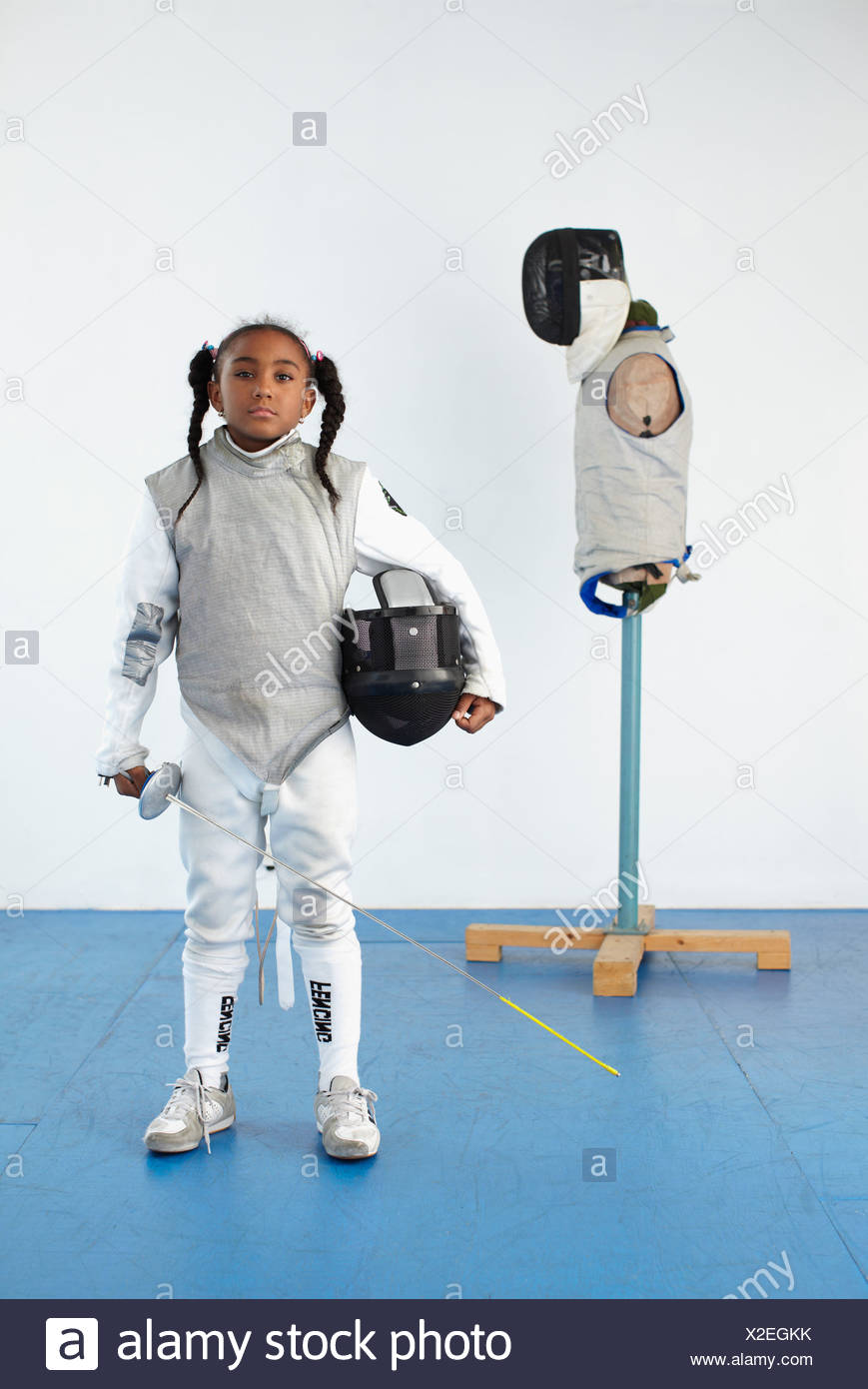 Portrait of girl in fencing gear - Stock Image