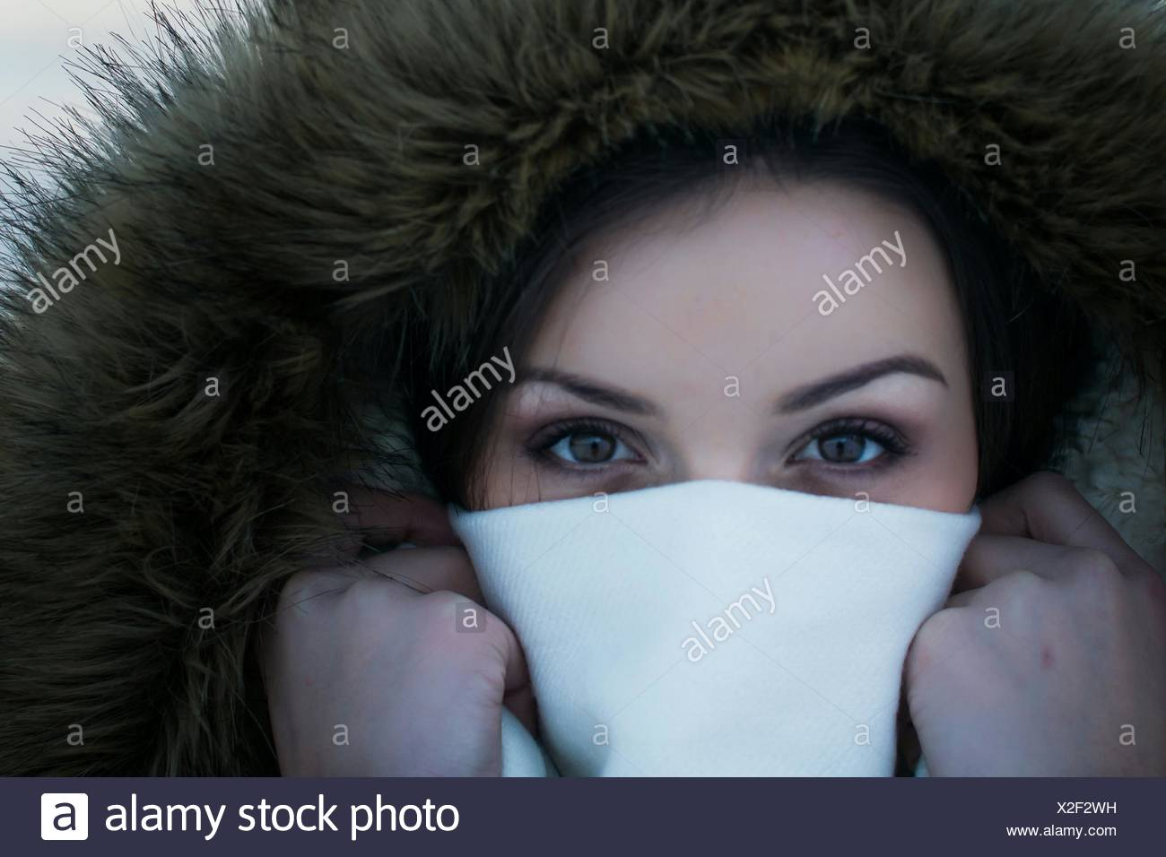 Close-Up Portrait Of Young Woman Covering Face With Napkin - Stock Image