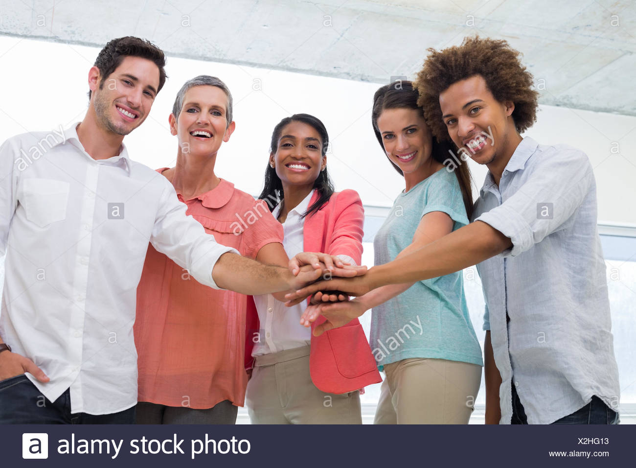 Attractive business people uniting at work - Stock Image