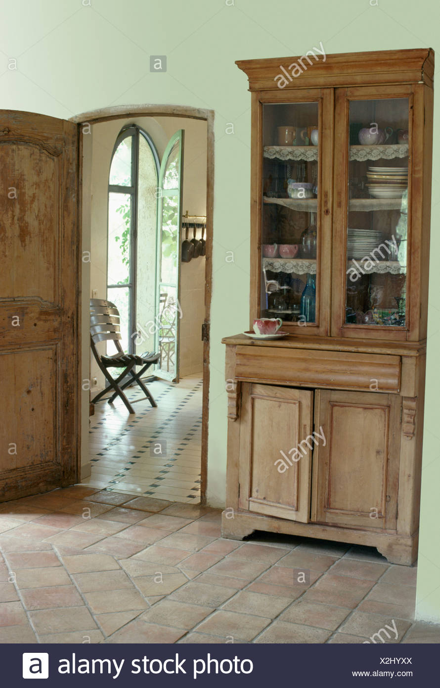 Antique Glass Front Dresser In French Country Hall With Terracotta