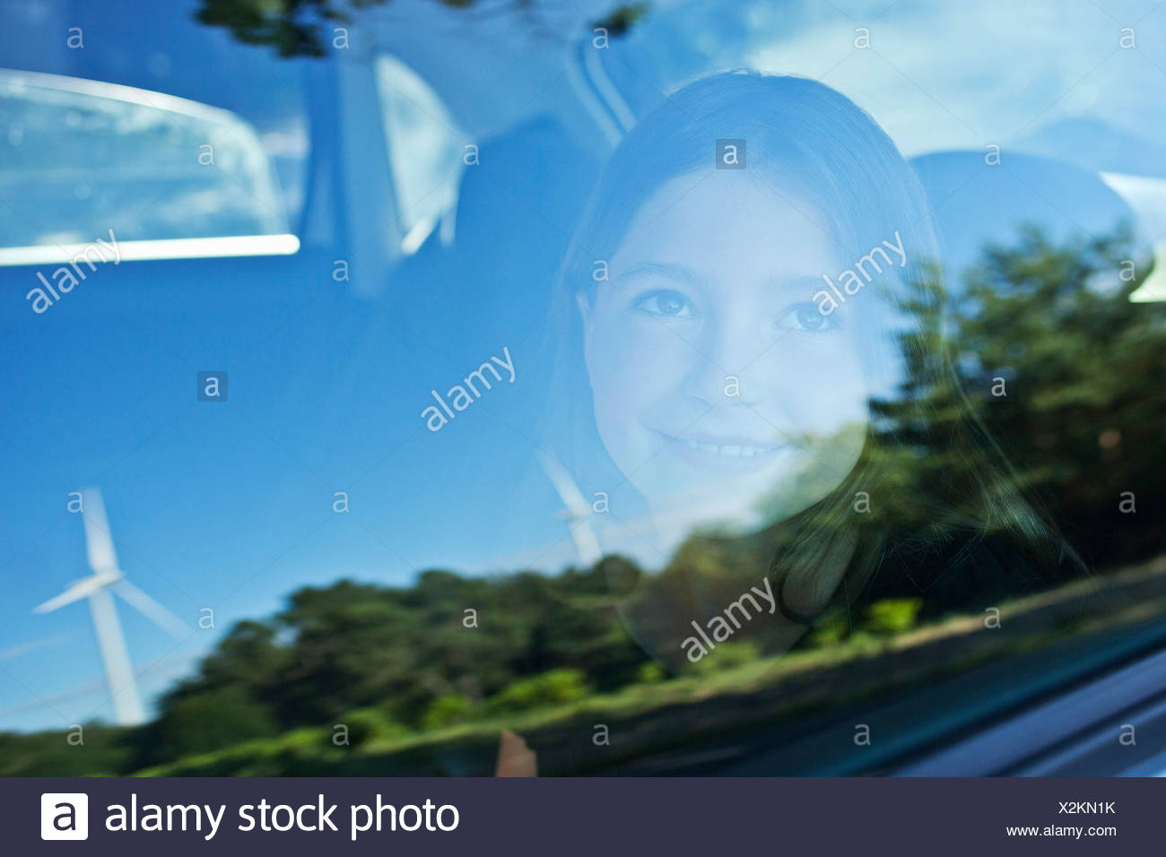 Wind turbines reflected in car window - Stock Image