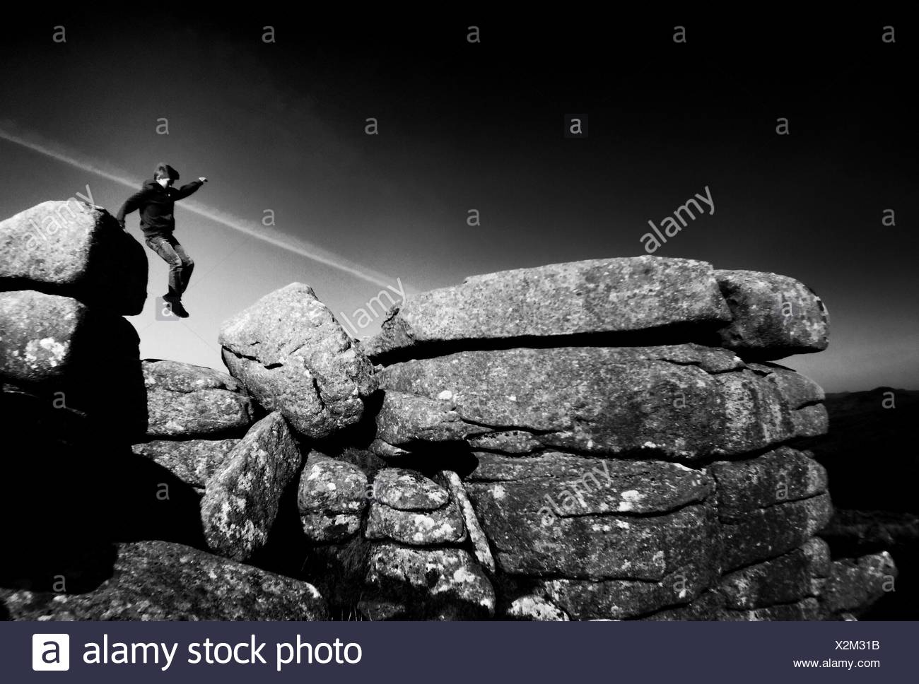 Boy Jumping Against Sky - Stock Image