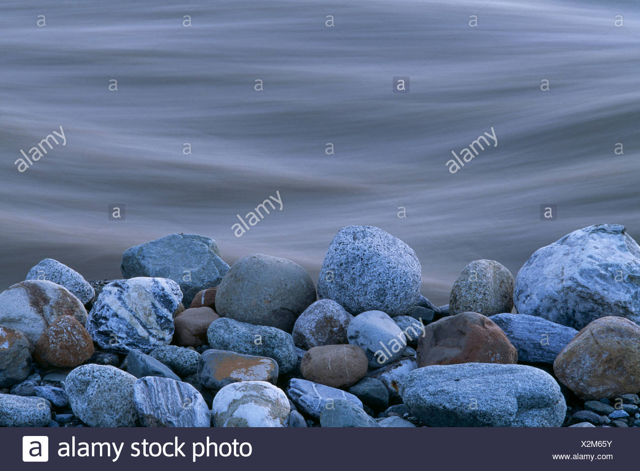 A close-up of the rocks on the shore of the Tashenshini River, Yukon, Canada - Stock Image