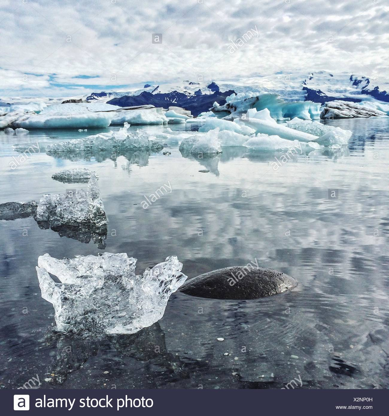 Glaciers Floating On Water In Lake - Stock Image