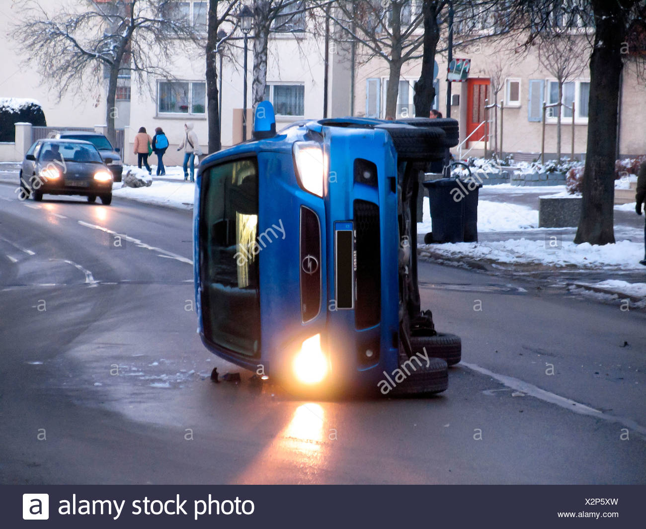 Car after an accident on an icy road, black ice - Stock Image