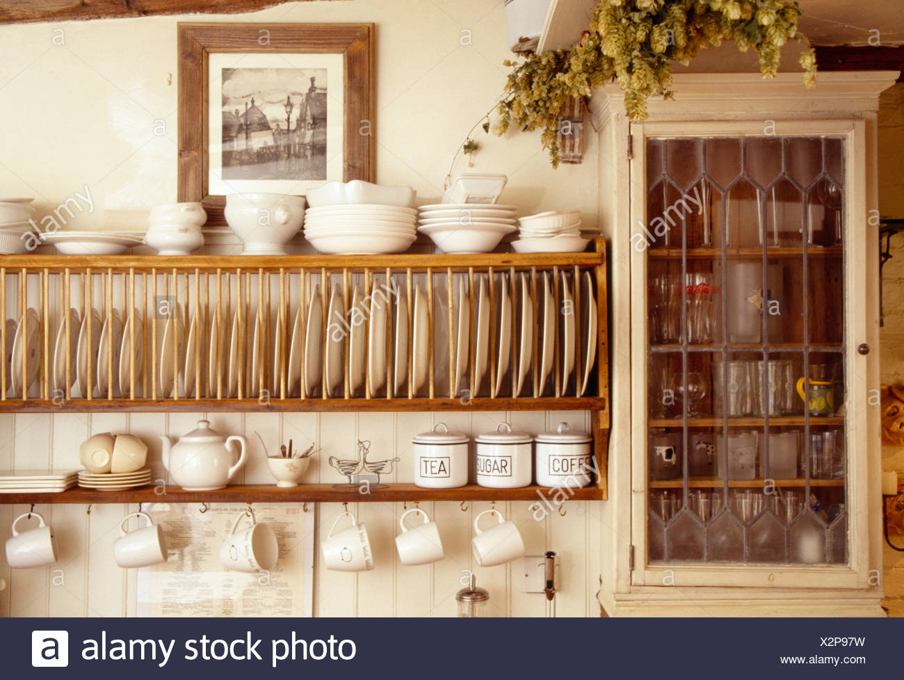 Close-up of cream bowls on wooden plate rack beside small wall cupboard in cottage & Plate Racks In Kitchen Stock Photos \u0026 Plate Racks In Kitchen Stock ...