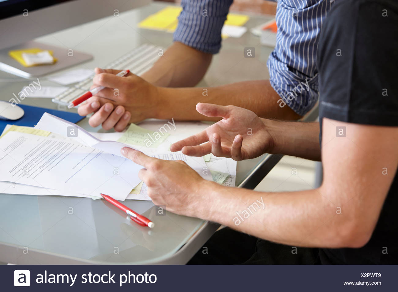 Two men with paperwork, close up - Stock Image