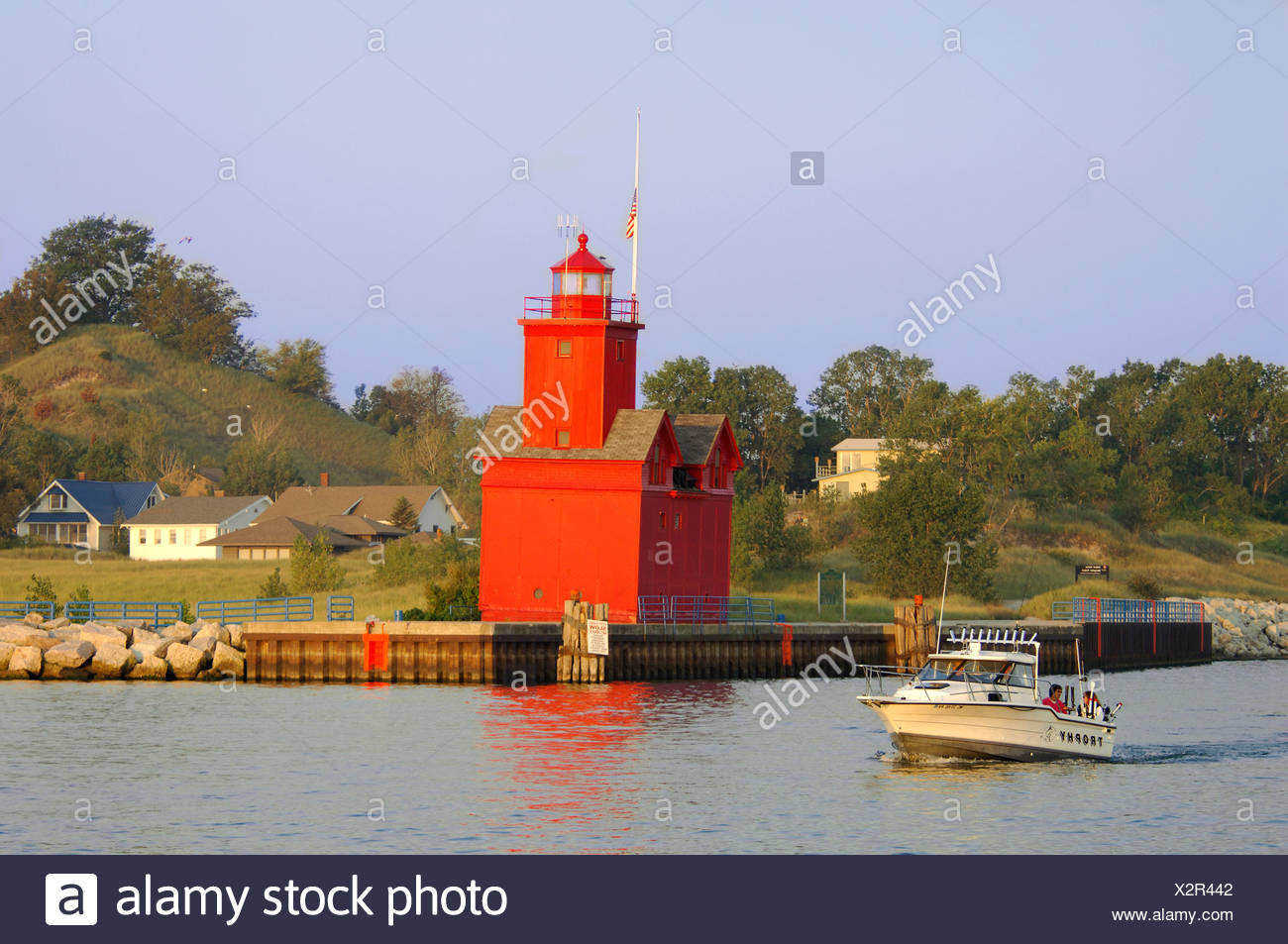 big red lighthouse lighthouse red boat motorboat michigan lake shore