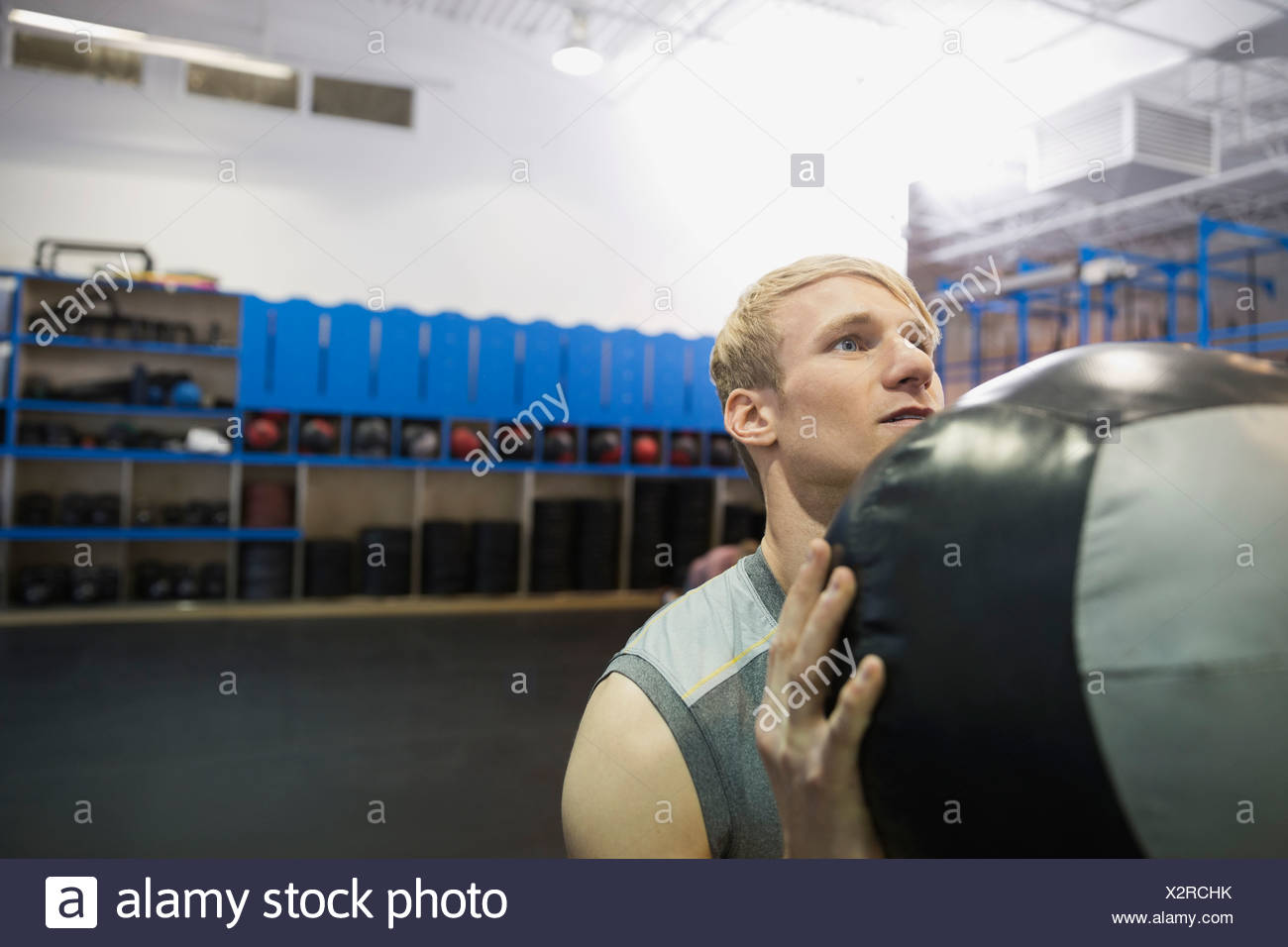 Man exercising with medicine ball - Stock Image