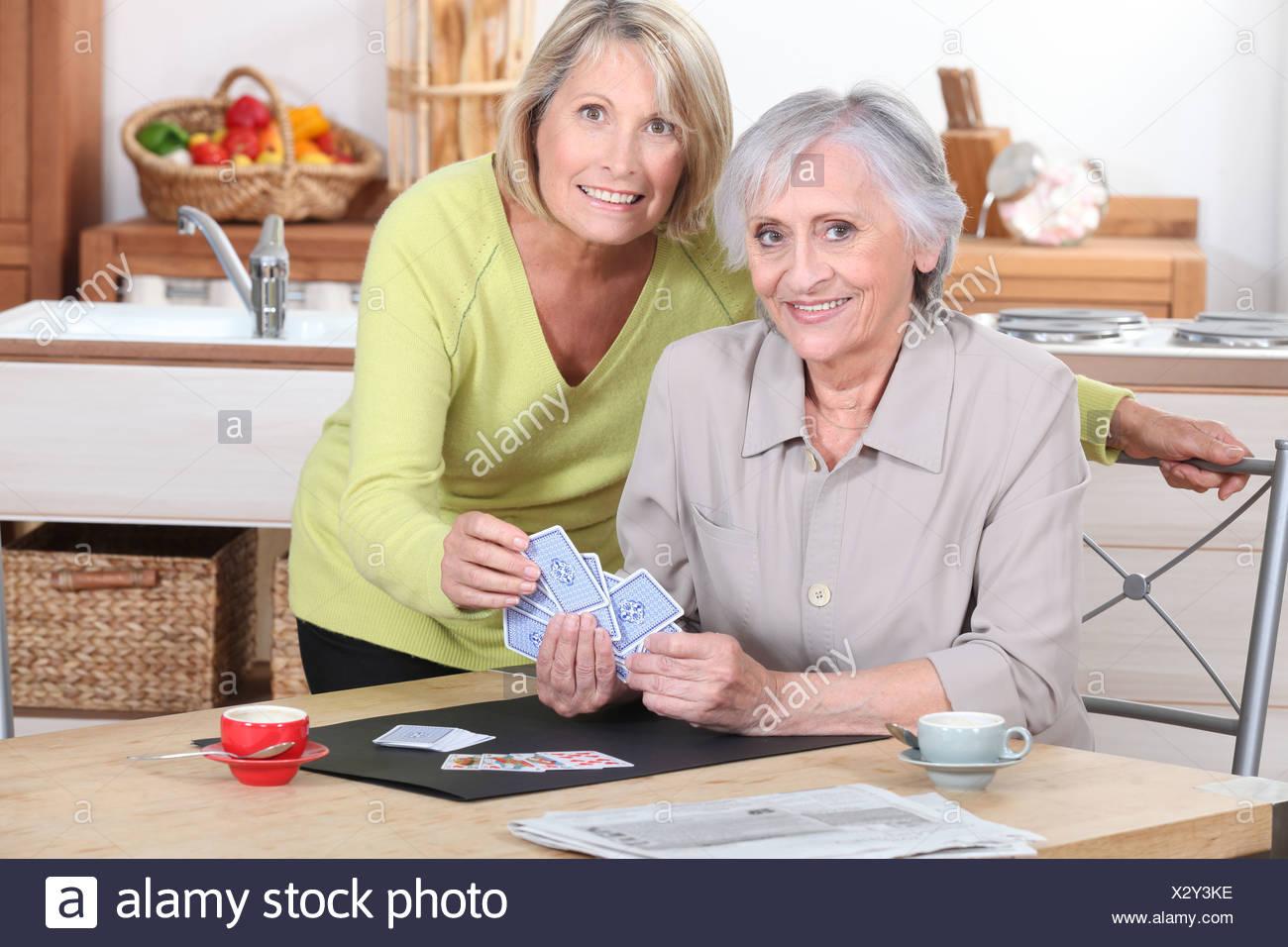 Two mature woman playing around