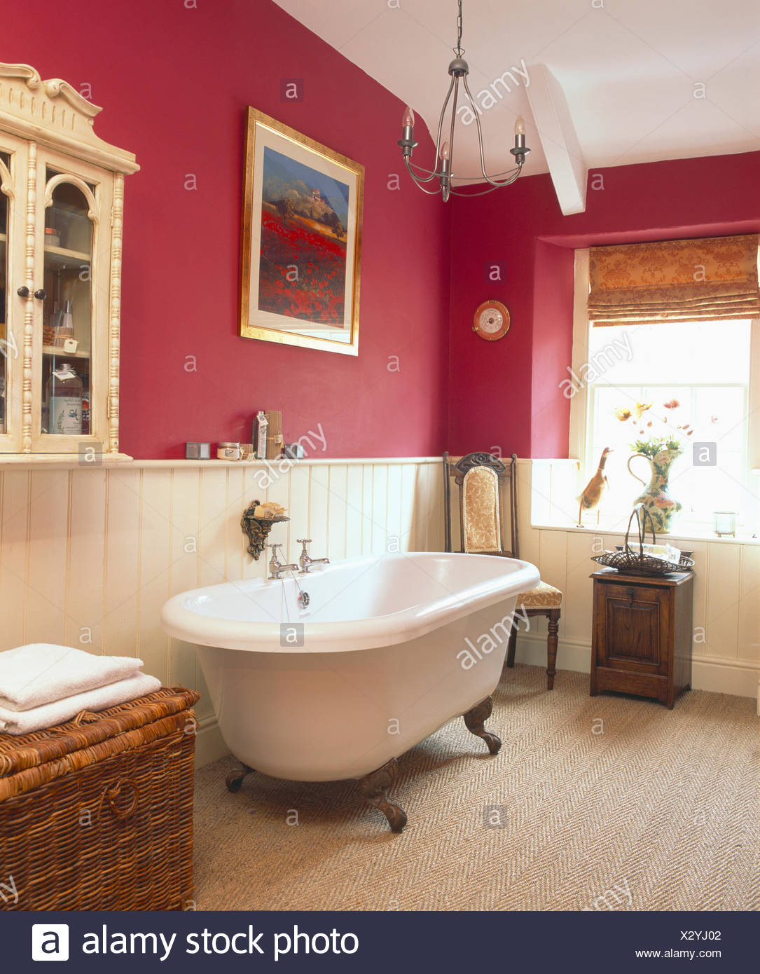 Rolltop Bath In Dark Pink Bathroom With Cream Tongue+groove Panelling And  Coir Carpet