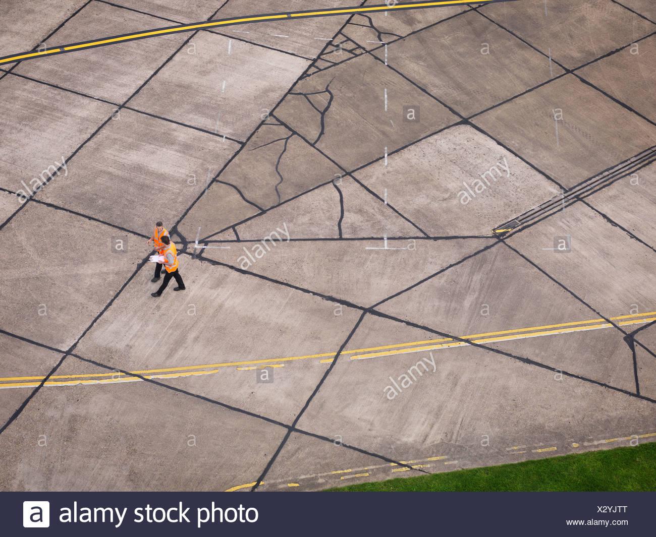 Engineers on aircraft runway - Stock Image