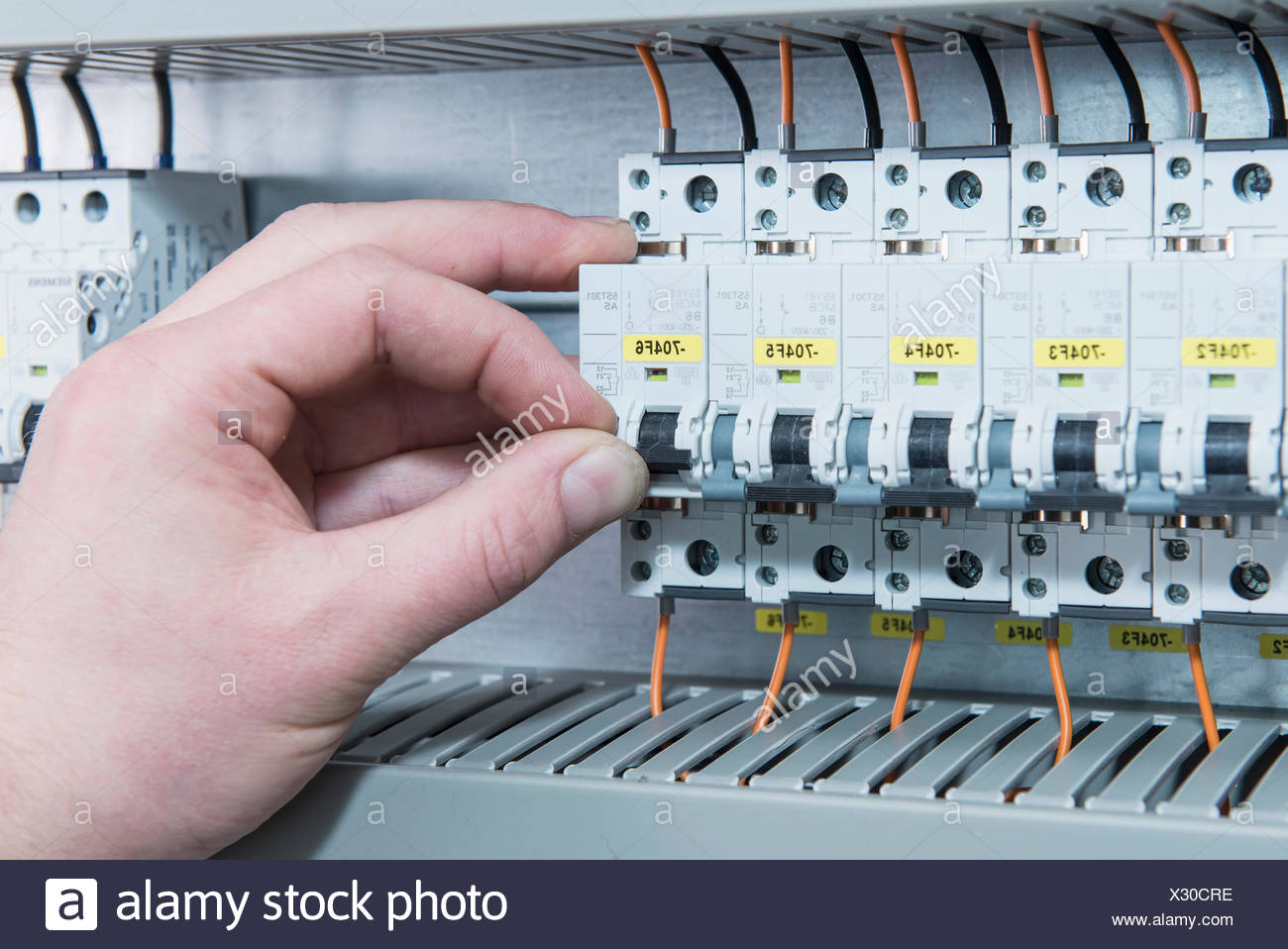 Close Up Of Electrician Switching Electrical Fuse In Distribution Box Fusebox Munich Bavaria Germany
